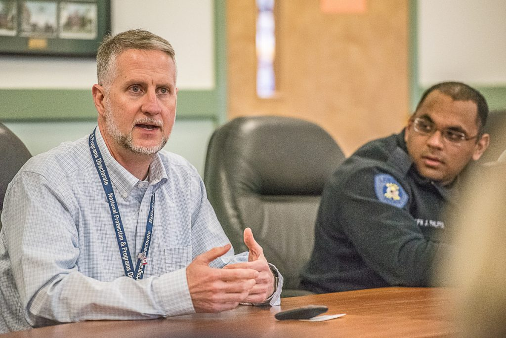 William DeLong, U.S. Department of Homeland Security, talks about active-shooter preparation to members of the Lewiston Auburn Metropolitan Chamber of Commerce as Joe Philippon, right, of the Lewiston Police Department, listens.