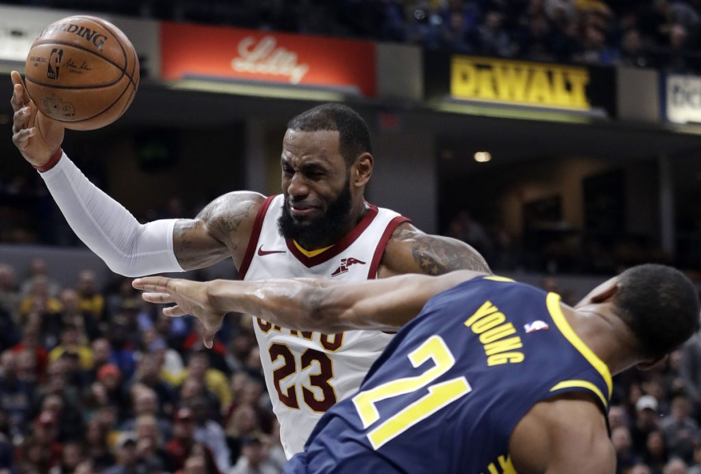 LeBron James of the Cleveland Cavaliers is fouled by Thaddeus Young of the Indiana Pacers while going up to shoot Friday night during the first half of Indiana's 97-95 victory. The Cavaliers have lost three straight games.