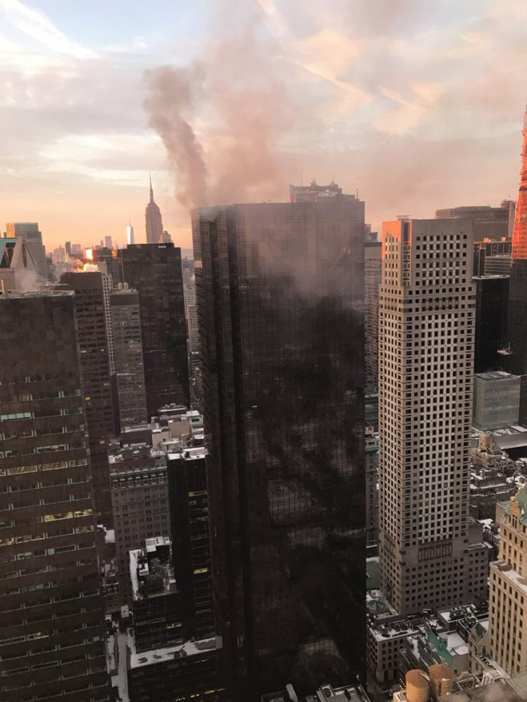 Smoke rises from Trump Tower in New York. The AP has found that stories circulating on the internet that this fire was an assassination attempt on the president are untrue.