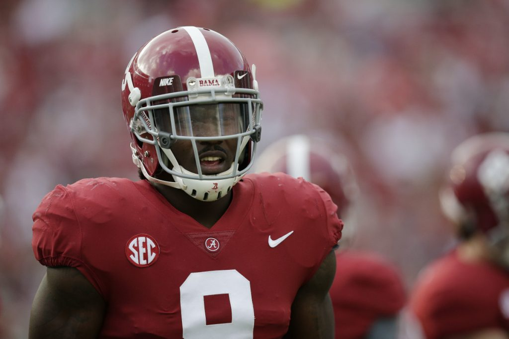 Alabama running back Bo Scarbrough walks on the field before a game in Tuscaloosa, Ala. The AP has found that stories circulating on the internet about Scarbrough losing his Alabama scholarship after yelling an obscenity about President Trump are untrue.