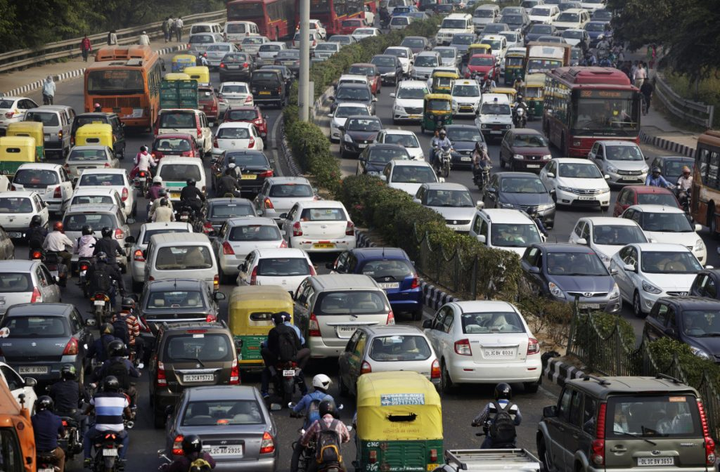 Traffic moves along a highway during morning rush hour in Delhi, India.