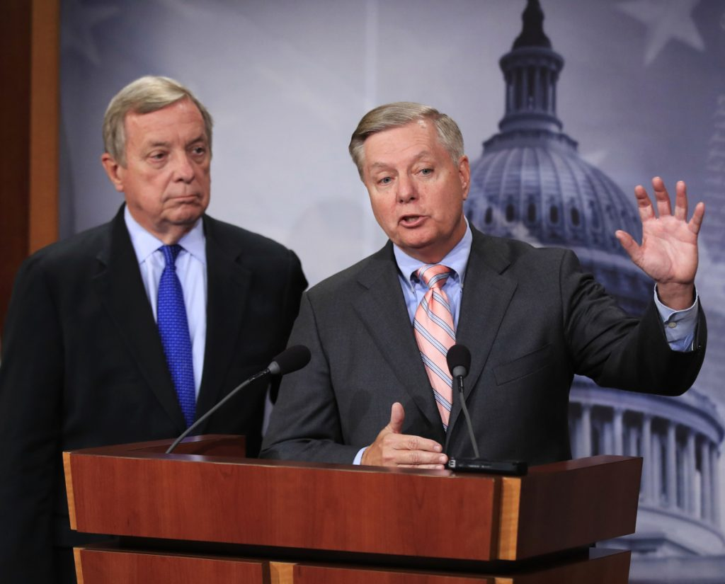 Sen. Lindsey Graham, R-S.C., right, and Sen. Dick Durbin, D-Ill., have put forth an immigration plan that would give young illegal immigrants a path to citizenship and President Trump $1.6 billion for a border wall.