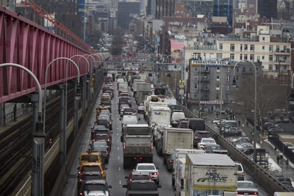 Traffic crosses the Williamsburg Bridge in New York from Brooklyn into Manhattan. A proposal to make part of Manhattan a toll zone is gaining momentum.