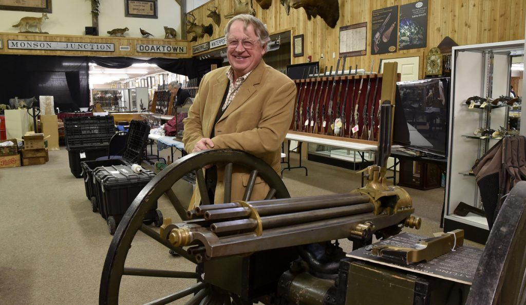 "Jim Julia with an 1870s Gatling gun that will be auctioned at his Fairfield business, James D. Julia Auctioneers Inc. Julia has sold the internationally known company, which he says has ""handled some of the greatest gun collections sold in this country in the last 20 years."""