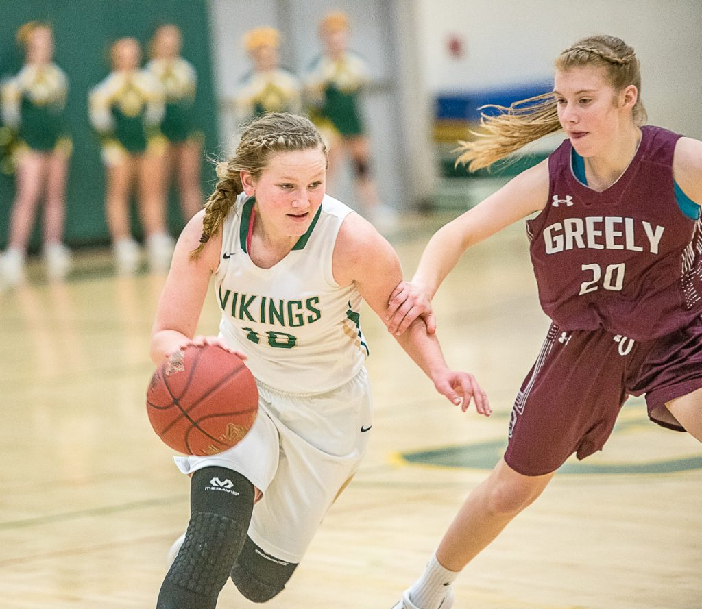 Ceceila Dieterich drives against Greely's Anna DeWolfe during their girls' basketball game Saturday in South Paris. Greely rallied for a 46-39 win.