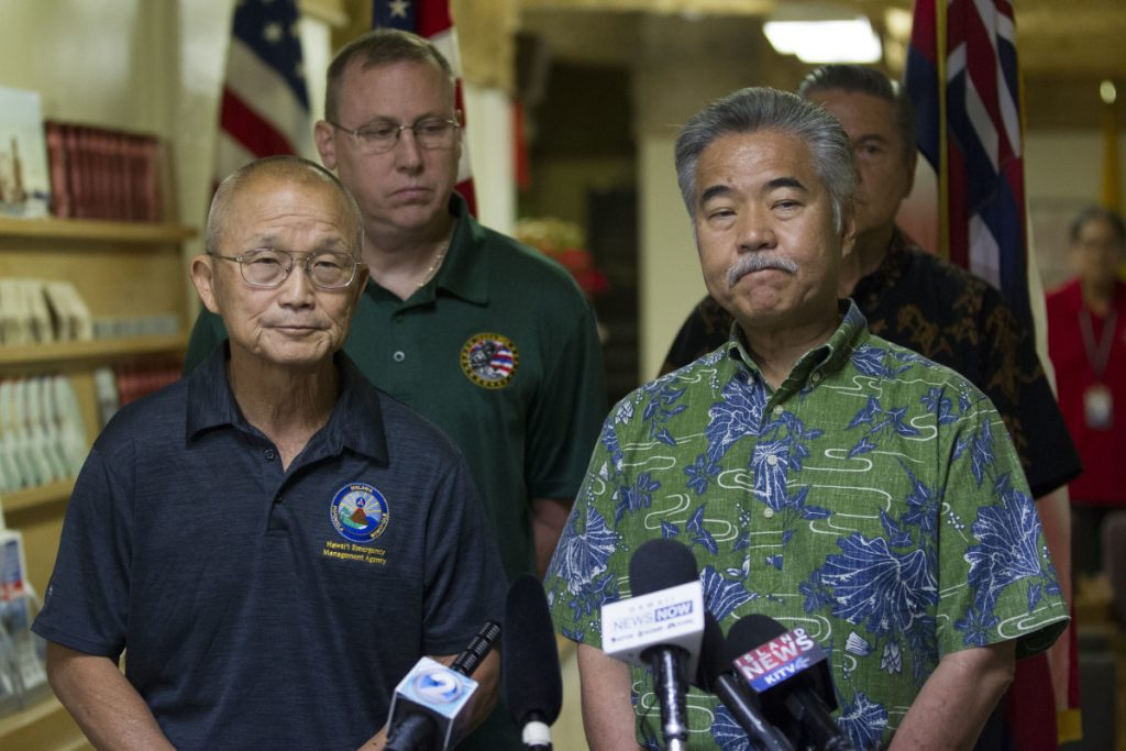 Vern Miyagi, administrator of Hawaii Emergency Management Agency, left, and  Hawaii Gov. David Ige addresse the media Saturday following the false alarm issued of a missile launch on Hawaii. (George F. Lee  /The Star-Advertiser via AP)
