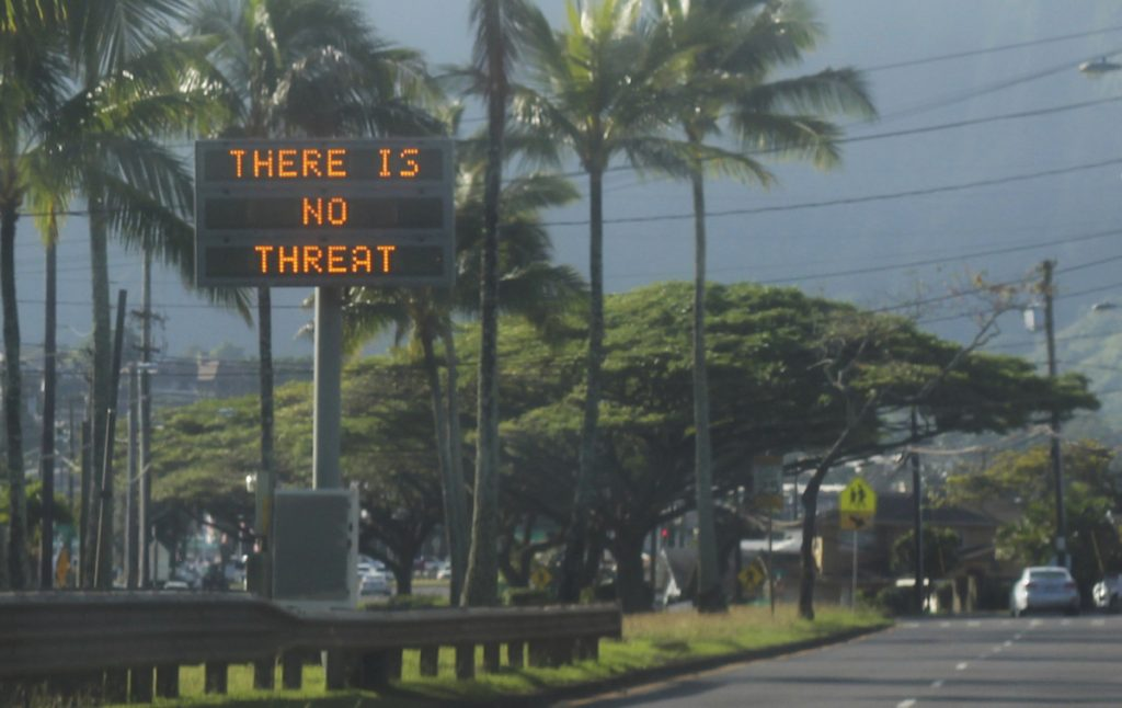 "A highway median sign broadcasts a message of ""There is no threat"" in Kaneohe, Hawaii, on Saturday after an emergency alert warning of an imminent missile strike mistakenly went out. (Jhune Liwanag via The AP)"