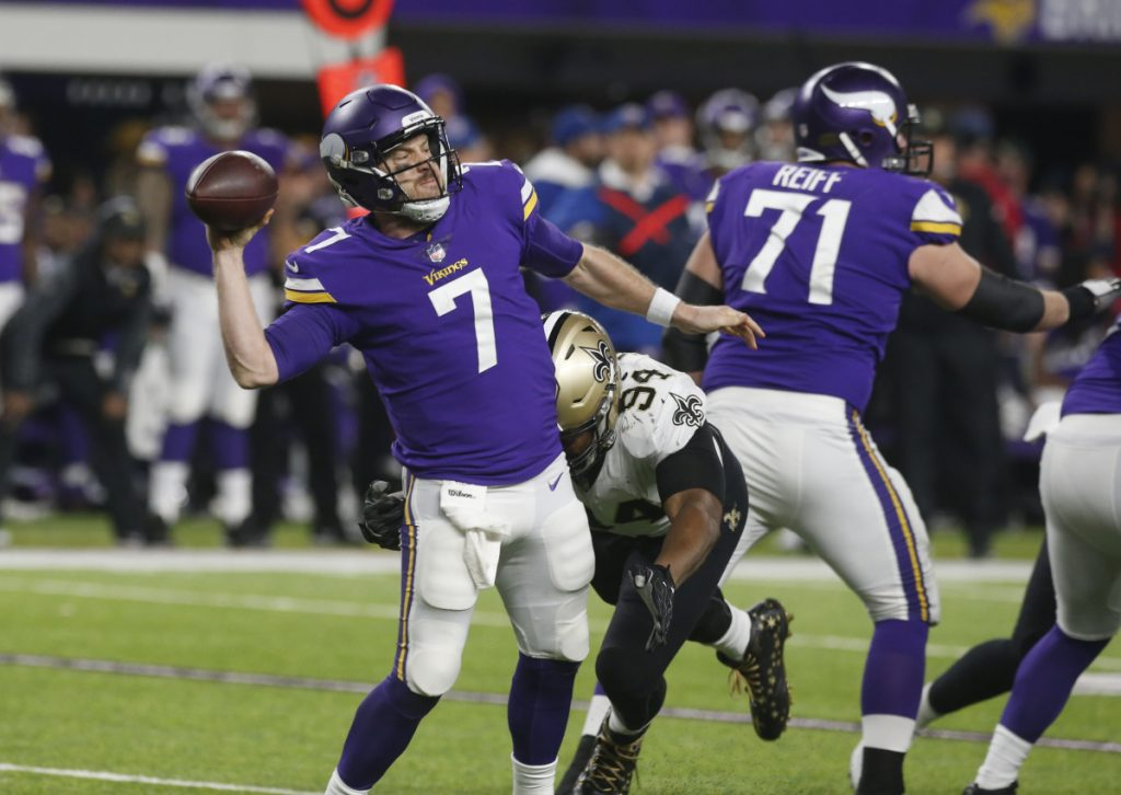 Minnesota quarterback Case Keenum is pressured by New Orleans defensive end Cameron Jordan during the second half of the Vikings' 29-24 win Sunday in Minneapolis. The Vikings scored on the game's final play and advance to face Philadelphia in the NFC title game.