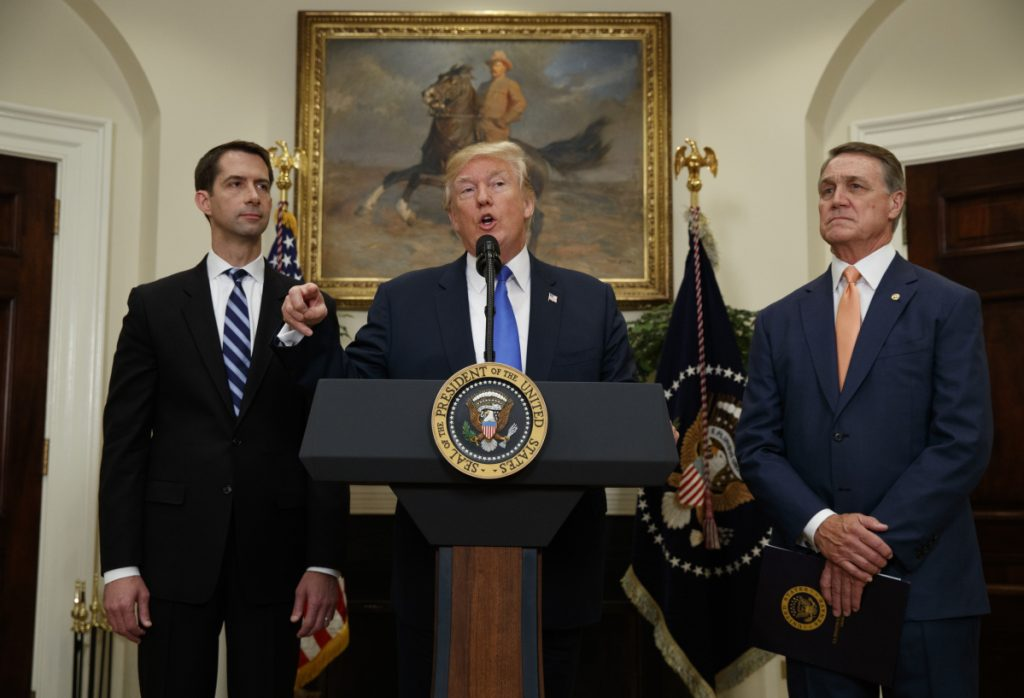 "Sens. Tom Cotton, R-Ark., left, and David Perdue, R-Ga., right – who previously said they could not recall whether President Trump, center, had referred to ""sh--hole countries"" at a meeting they all attended – denied outright on TV news programs Sunday that Trump had ever said it."