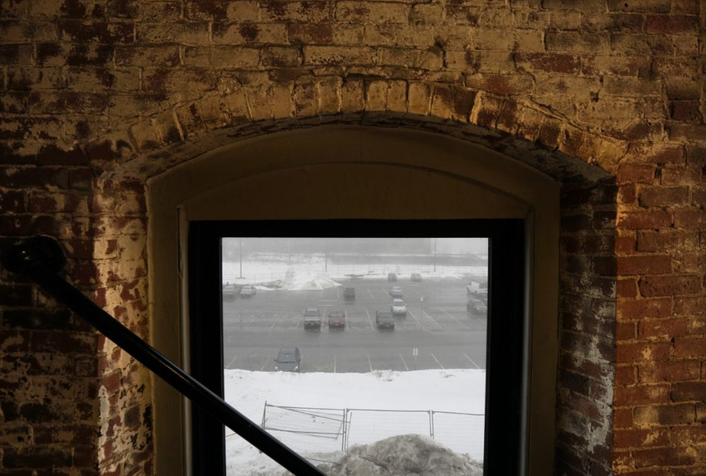 BIDDEFORD, ME - JANUARY 12: The site of the former Maine Energy Recovery Company, seen here through the window of a neighboring building in a photo taken on Friday, January 12, 2018, is one of three sites for a 400-car parking garage being considered by the Biddeford City Council. Officials say the parking garage is necessary for further economic development. (Staff Photo by Gregory Rec/Staff Photographer)
