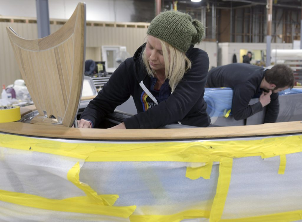 Molly Edwards and Aaron Arsenault work on a Carbon Craft tender at Southport Boats in Gardiner on Monday. Formerly part of Augusta's Kenway Corp., Southport has relocated to Gardiner under new ownership and will continue to produce its line of powerboats there.