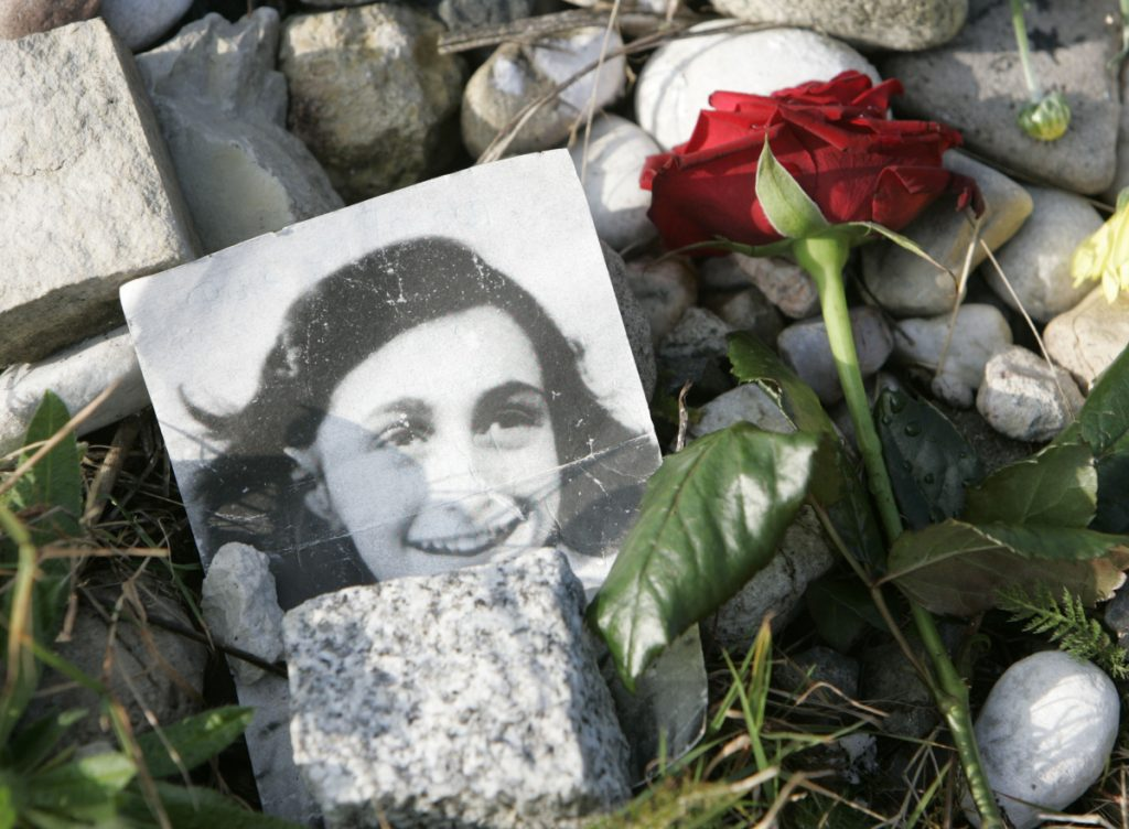 A photo of Anne Frank, who famously chronicled the two years when her family was hidden from the Nazis, is seen at a memorial at the concentration camp where she died.