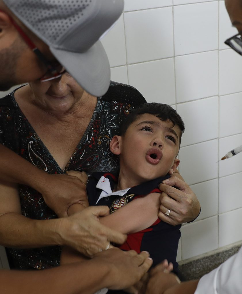 A boy receives a vaccine against yellow fever at a public health center in Sao Paulo, Brazil, Tuesday