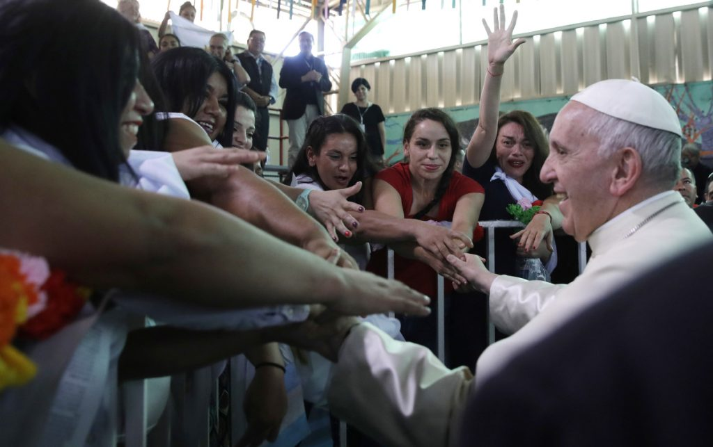 Pope Francis greets inmates at the San Joaquin women's prison in Santiago, Chile, on Tuesday.