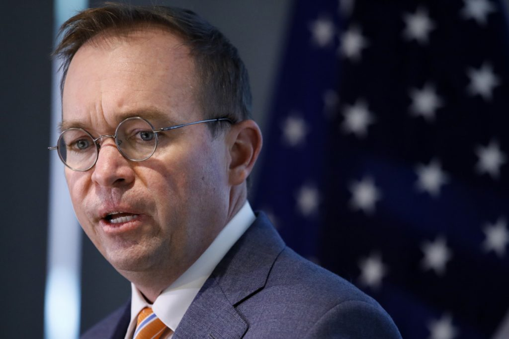 Mick Mulvaney speaks during a news conference after his first day as acting director of the Consumer Financial Protection Bureau in Washington. The CFPB is reconsidering a key set of rules enacted in 2017
