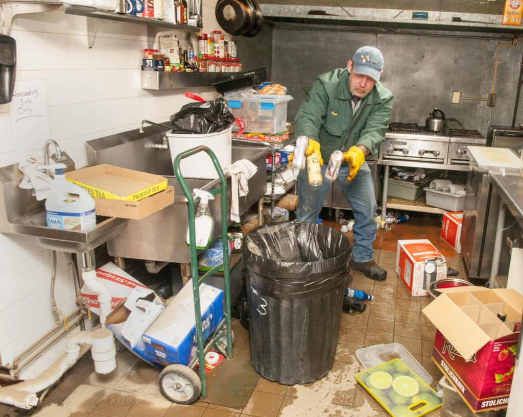 Owner Wayne Hyde cleans up the kitchen of the Hydeout at the Wharf around 9:40 a.m. Tuesday in Hallowell.