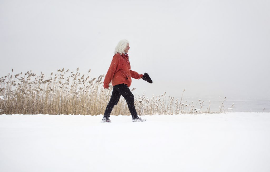 """PORTLAND, ME - JANUARY 17: Susu Smith of Portland walks at Back Cove during a snowstorm on Wednesday, Jan. 17, 2018. """"You just have to get out in it"""", said Smith, who says she walks everyday in all sorts of weather. """"It has become a habit"""". (Photo by Derek Davis/Staff photographer)"""