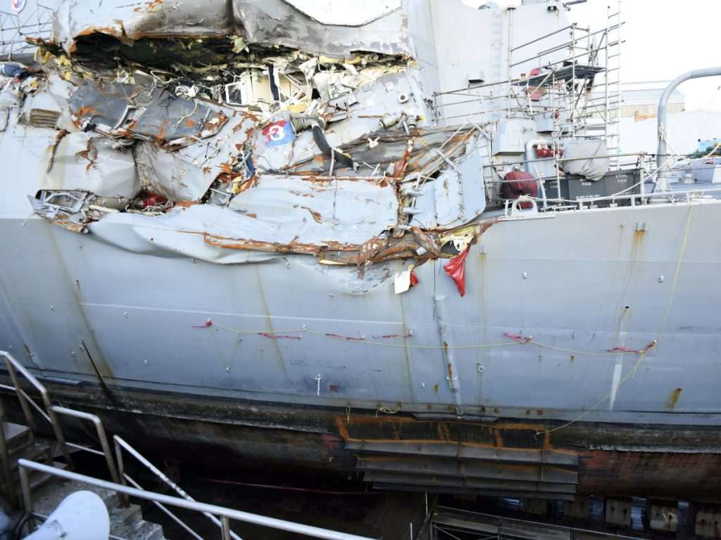 The USS Fitzgerald sits in dry dock in Yokosuka, Japan, in July 2017 to continue repairs and assess damage sustained in a June 17 collision with a cargo ship in the waters off Japan.