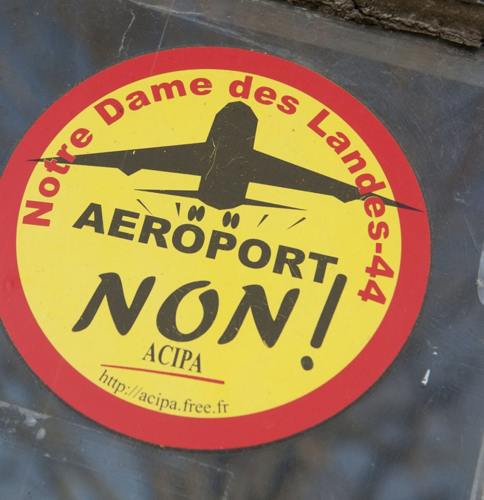 "A sticker reading ""No to the airport"" adorns the window of a farm in western France. Plans for the airport were first made 50 years ago."