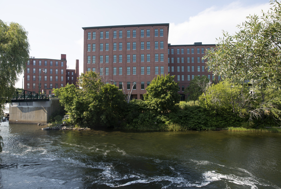 Maine Medical Center is moving the first of about 500 workers to the largest building in downtown Westbrook, One Riverfront Plaza, seen from across the Presumpscot River.