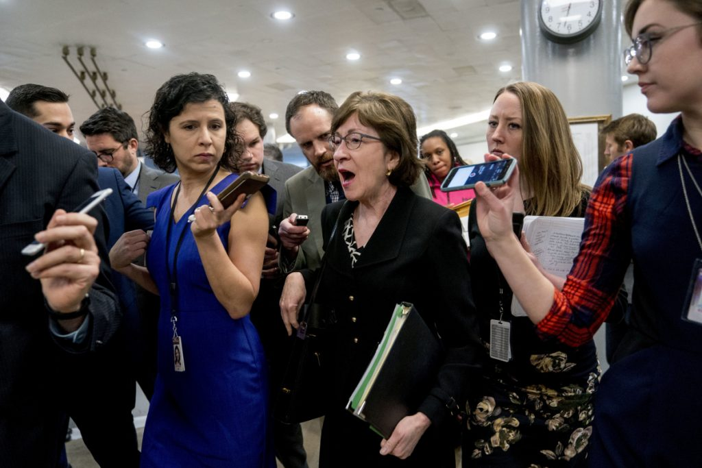 U.S. Sen. Susan Collins, R-Maine, speaks to reporters Thursday while walking toward the Senate chamber as Congress moves closer to its deadline to avoid a government shutdown.