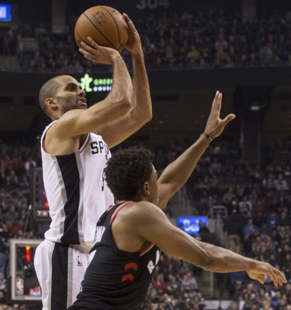 San Antonio guard Tony Parker shoots over Raptors guard Kyle Lowry during the first half of Toronto's 86-83 victory at home Friday night.