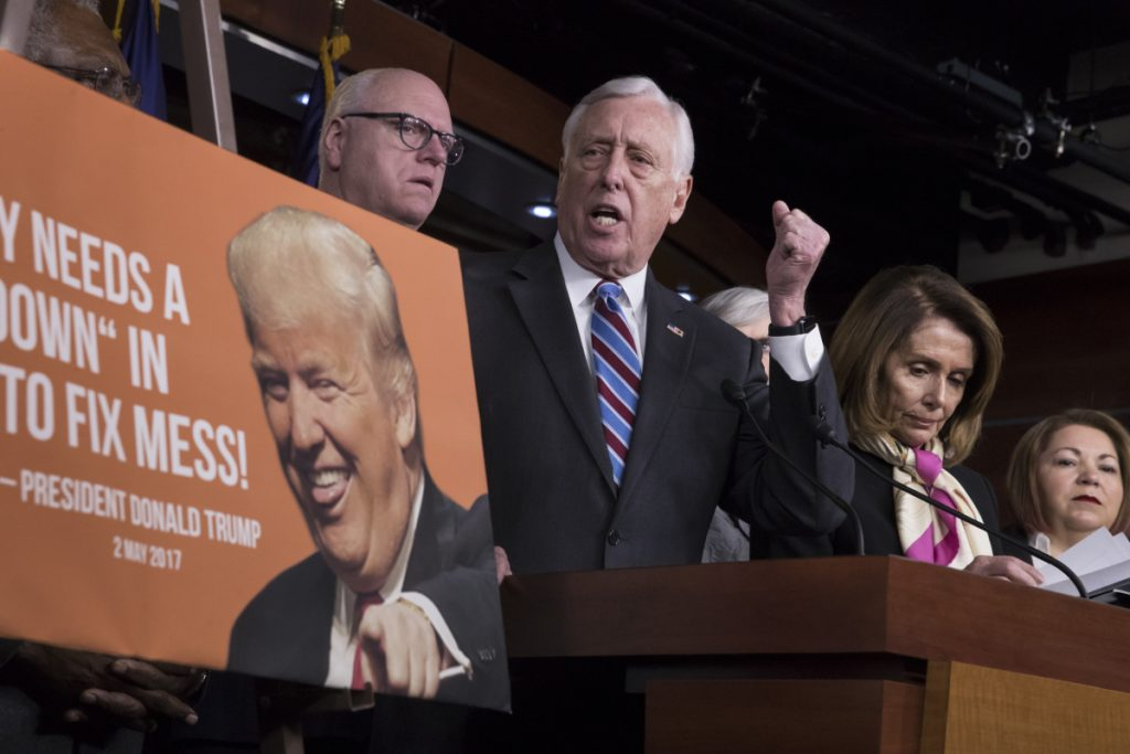 House Minority Whip Steny Hoyer, D-Md., center, joined from left by, Rep. Joseph Crowley, D-N.Y., House Minority Leader Nancy Pelosi, D-Calif., and Rep. Linda Sanchez, D-Calif., speaks at a news conference on the first morning of a government shutdown after a divided Senate rejected a funding measure Friday night, at the Capitol in Washington on Saturday.