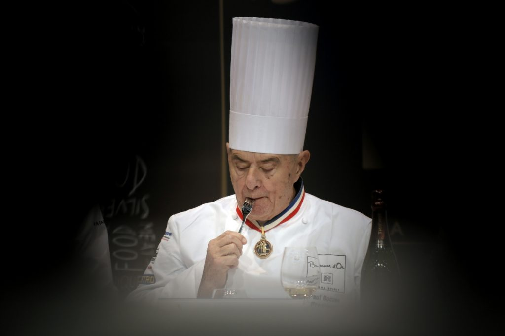 French chef Paul Bocuse tastes a dish during the