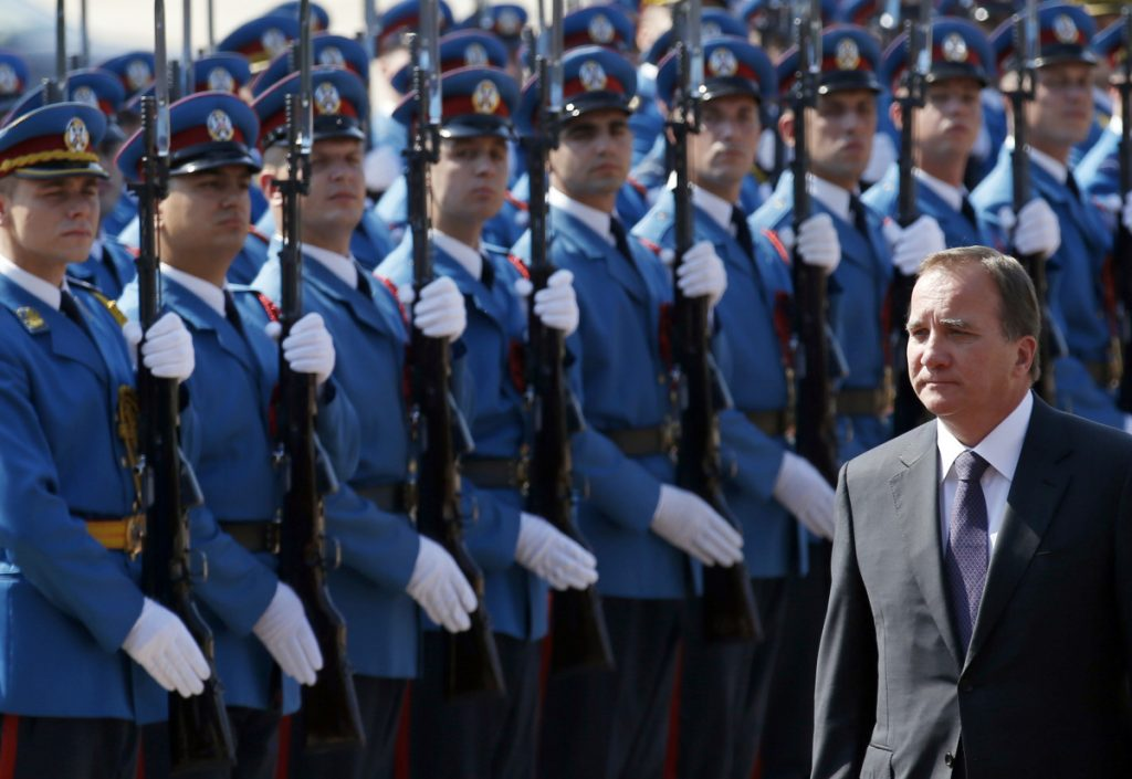 Swedish Prime Minister Stefan Lofven reviews an honor guard upon his arrival at the Serbia Palace in Belgrade, Serbia. Stories circulating on the internet about Sweden preparing for a civil war are made up.