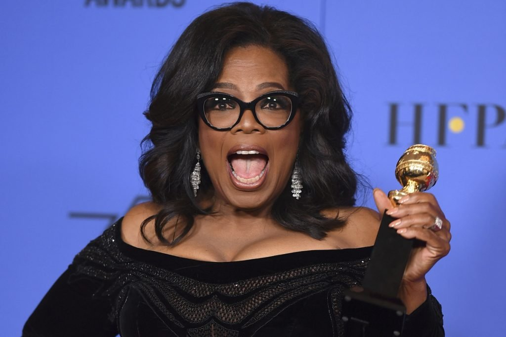 Oprah Winfrey poses in the press room with the Cecil B. DeMille Award at the 75th annual Golden Globe Awards. Stories circulating on the internet about Winfrey saying that old white people need to die are untrue.
