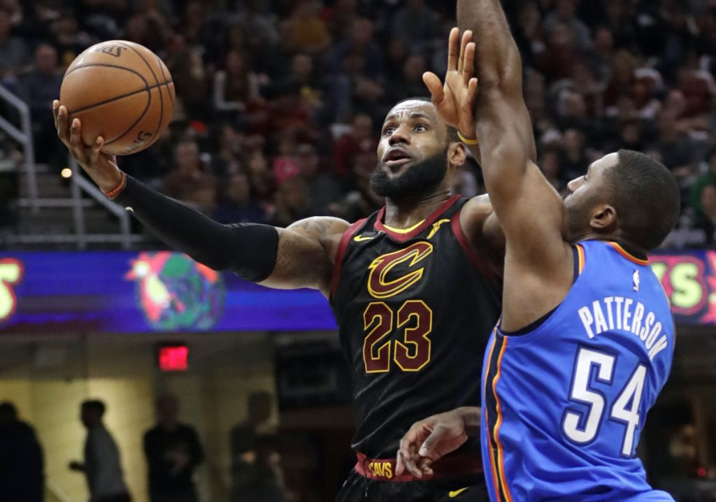 Cleveland's LeBron James drives to the basket while being defended by Oklahoma City's Patrick Patterson during the Thunder's 148-124 win Saturday in Cleveland. James scored 18 points and is seven shy of 30,000 for his career.