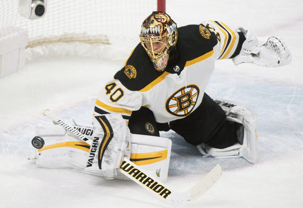 Boston Bruins goaltender Tuukka Rask makes a save against the Montreal Canadiens during the first period of an NHL hockey game, Saturday, Jan. 20, 2018 in Montreal. (Graham Hughes/The Canadian Press via AP)