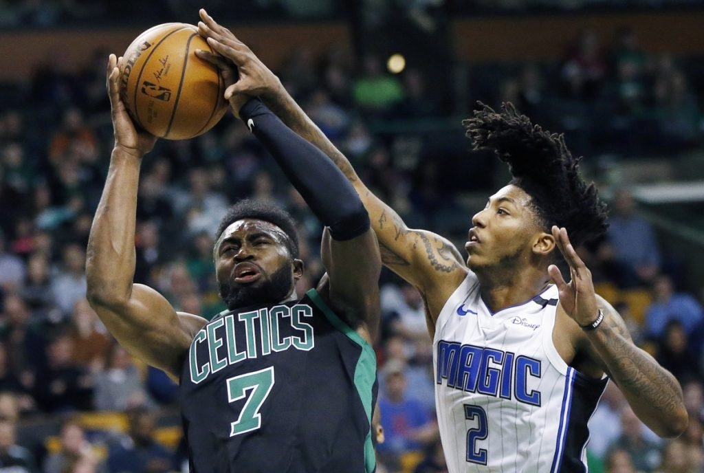 Boston's Jaylen Brown shoots while being defended by Orland's Elfrid Payton during the Celtics' 103-95 loss Sunday in Boston.