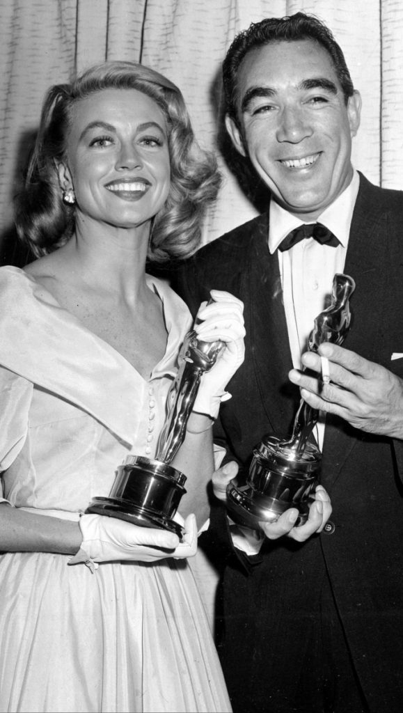 Best supporting Oscar winners Dorothy Malone and Anthony Quinn pose at the Academy Awards in Hollywood, Calif., in 1957.