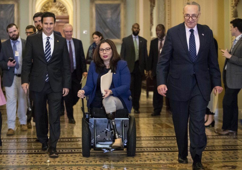 """An Illinois Democrat, Sen. Tammy Duckworth, says she took offense to President Trump's weekend tweet accusing Democrats of """"holding our military hostage."""""""