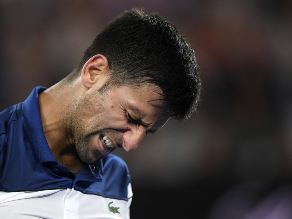 Novak Djokovic grimaces during his fourth round match against Hyeon Chung at the Australian Open in Melbourne on Monday. Djokovic, a six-time champion, lost to Chung in straight sets.