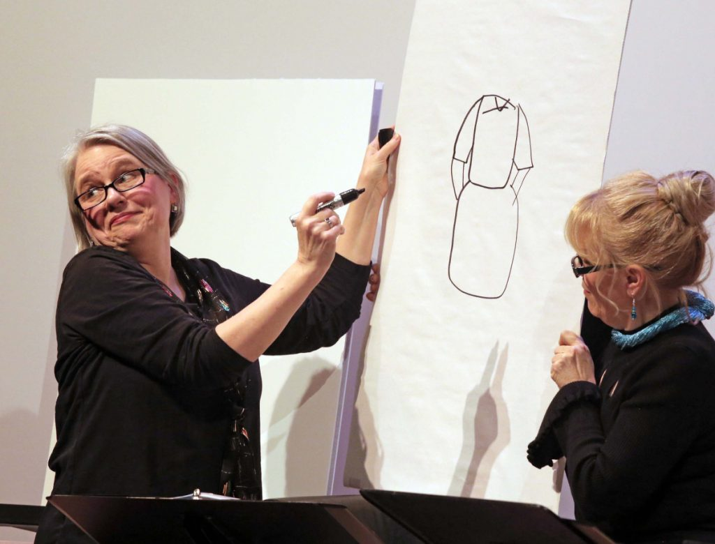 Amy Roche draws while Lynne McGhee watches in the show on stage at St. Lawrence Arts.