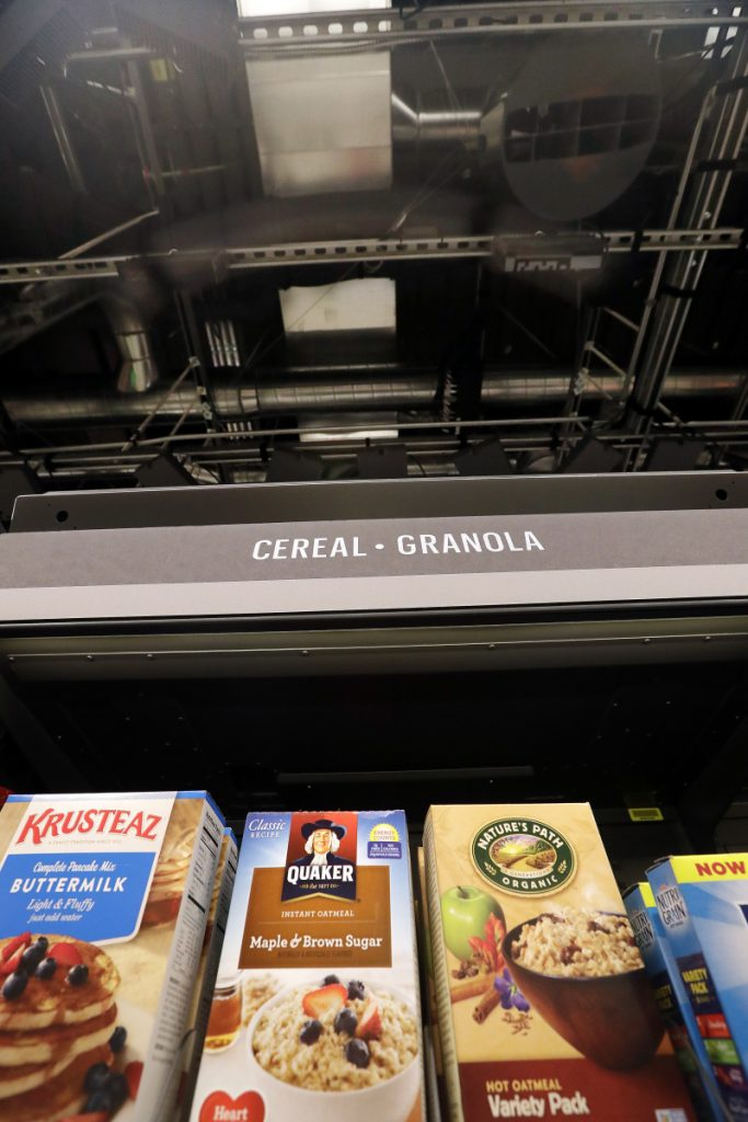 Sensors and cameras, part of a system used to tell what people have purchased, are attached overhead in an Amazon Go store, Monday, Jan. 22, 2018, in Seattle. More than a year after it introduced the concept, Amazon opened its artificial intelligence-powered Amazon Go store in downtown Seattle on Monday.  (AP Photo/Elaine Thompson)
