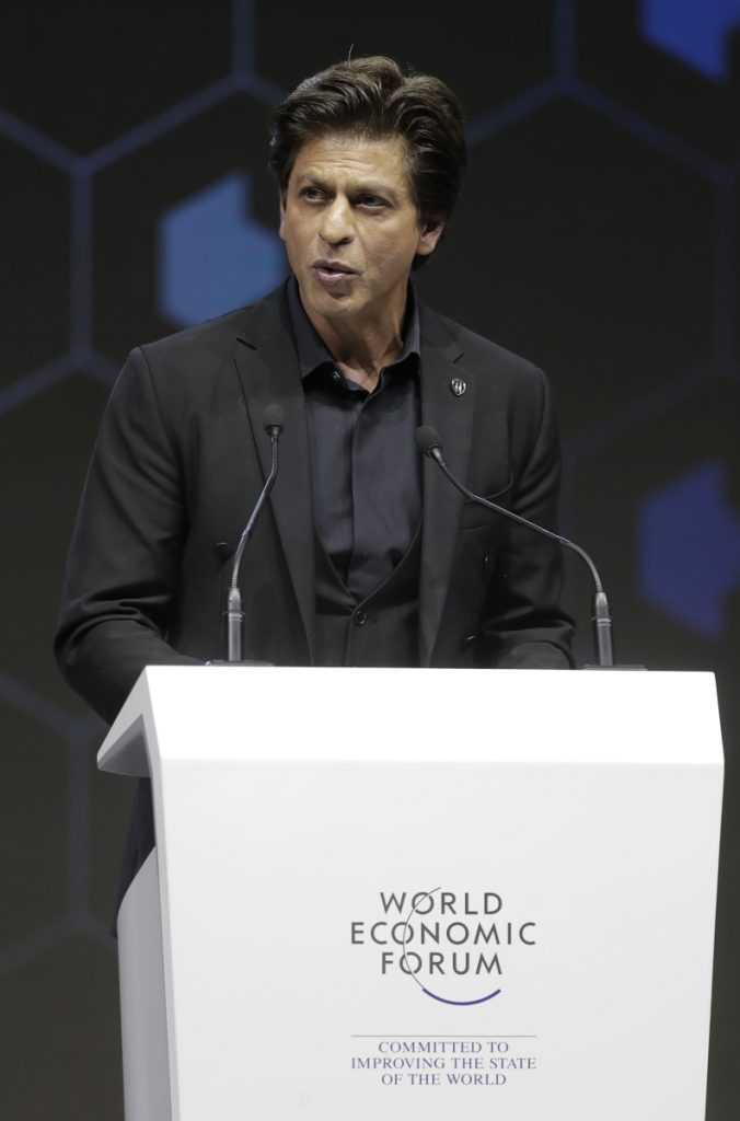 Indian actor Shah Rukh Khan delivers a speech when receiving a Crystal Award during a ceremony on the eve of annual meeting of the World Economic Forum in Davos, Switzerland, Monday, Jan. 22, 2018. The award celebrates the achievements of leading artists who are bridge-builders and role models for all leaders of society. (AP Photo/Markus Schreiber)