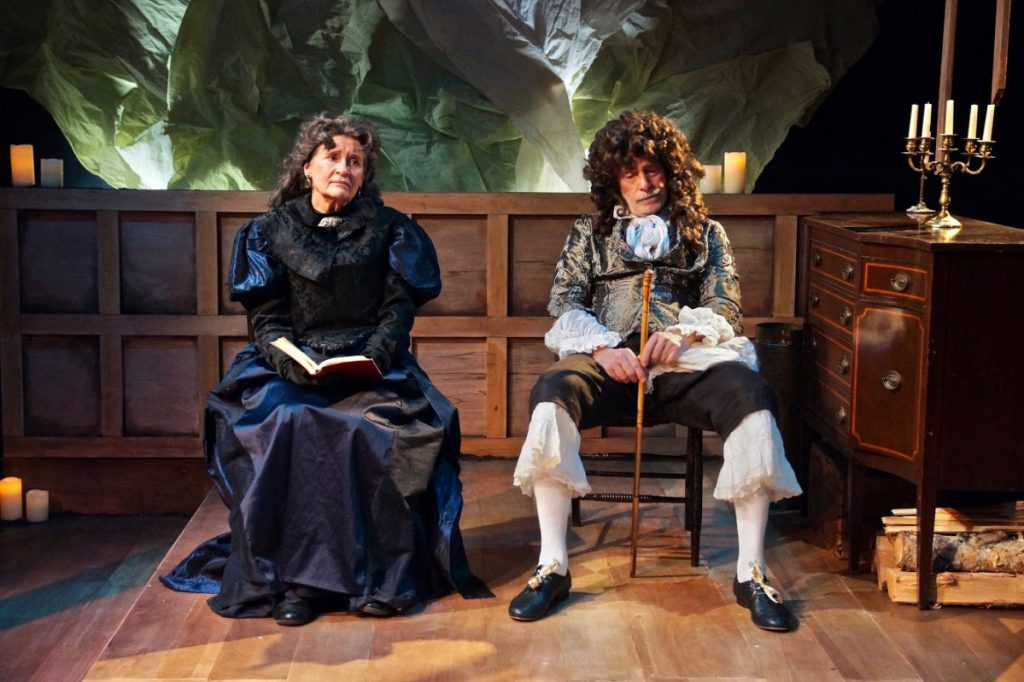 Deborah Paley as Mrs. Darcy Snelgrave and Payne Ratner as Mr. Snelgrave.