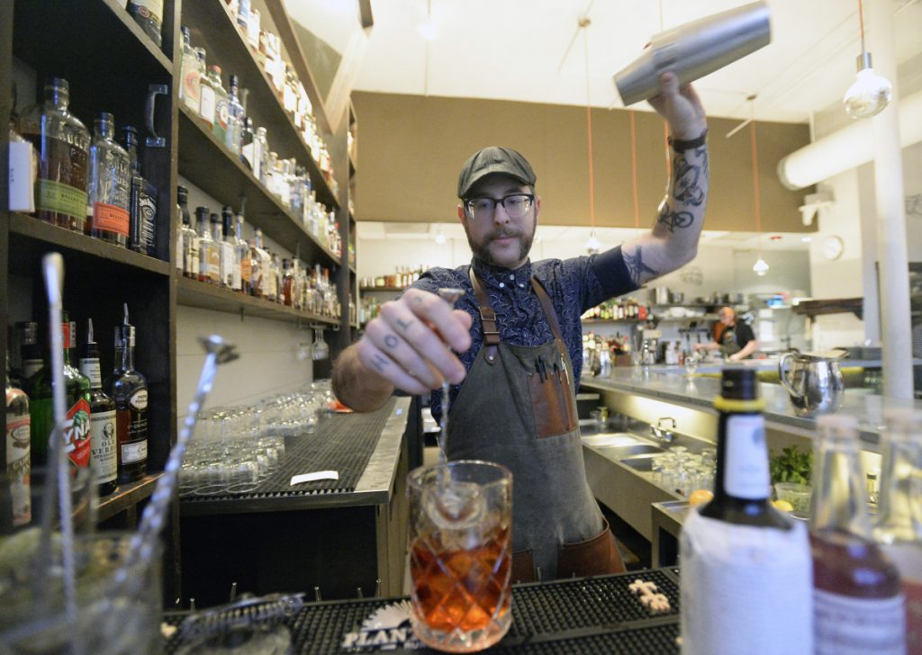 Bartender Ryan Wilmsmeier at work at Portland Hunt and Alpine Club on Jan. 18. Wilmsmeier, who has been through the Safe Bars training, says it gave him more confidence in his ability to handle harassment situations on the job.