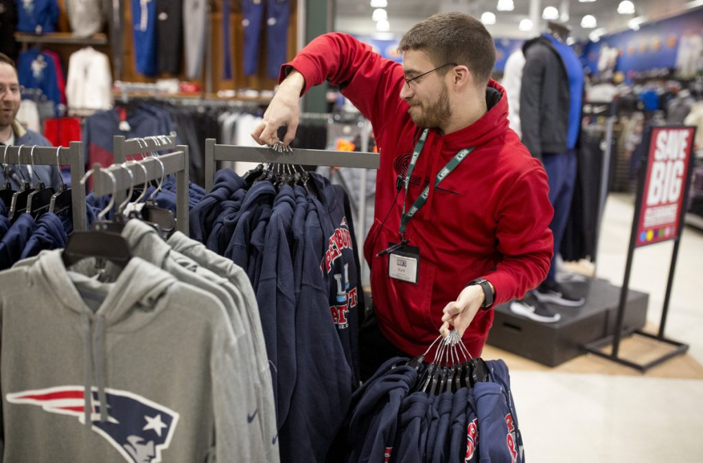 Kyle Jandreau puts out new Patriots merchandise at South Portland Dick s  Sporting Goods. The store 25902cfb9