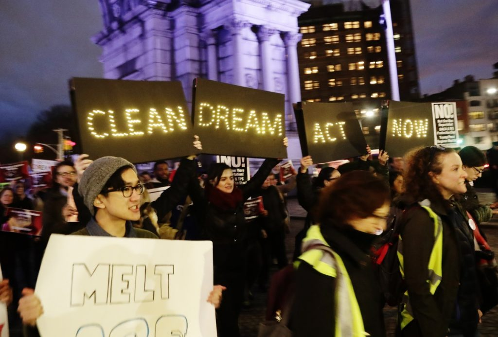 Protesters gather at Grand Army Plaza near the home of Sen. Charles Schumer, D-N.Y, Tuesday in the Brooklyn borough of New York, to register their displeasure at the senator's lack of progress on a DACA deal.