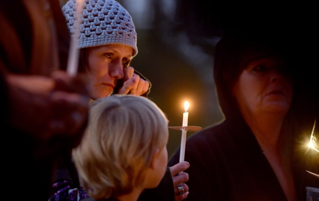At a domestic abuse awareness vigil last fall in Skowhegan, Jessica Hainer, above, said,