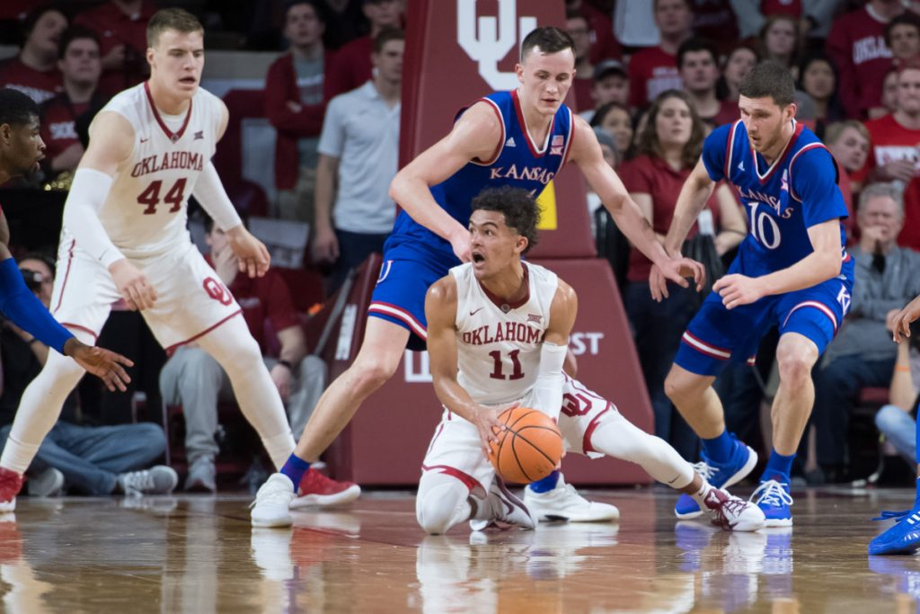Oklahoma guard Trae Young looks for an open teammate during Tuesday's game against Kansas. Young had 16 points as the No. 12 Sooners upset the No. 5 Jayhawks, 85-80.