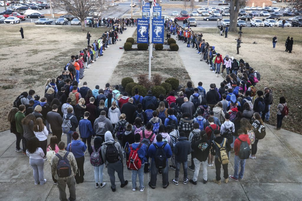 Paducah Tilghman High School held a prayer circle on Wednesday at the school for students at Marshall County High School, where two students were killed and 18 others were injured during a shooting on Tuesday in Kentucky.