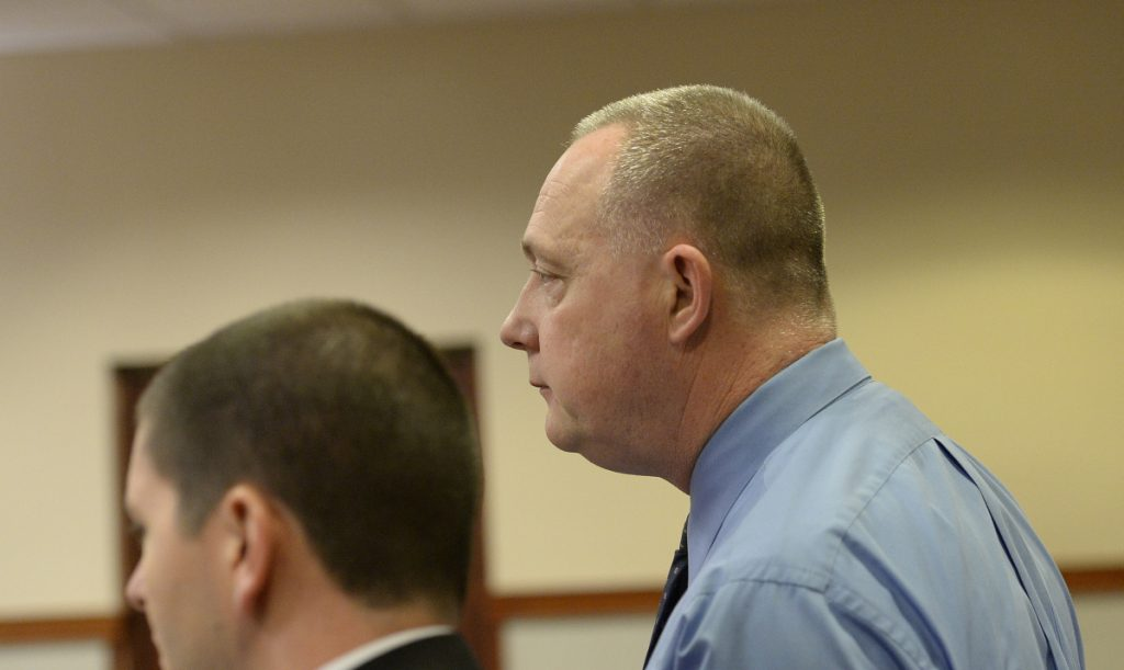 Retired Maine State Police trooper Jeffrey Linscott appears at Cumberland County Courthouse to face charges of trafficking in fentanyl and cocaine Thursday.