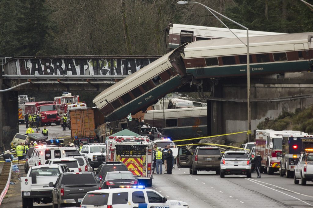 Amtrak train cars lie on Interstate 5 after a derailment in DuPont, Washington in Dec. 2017.