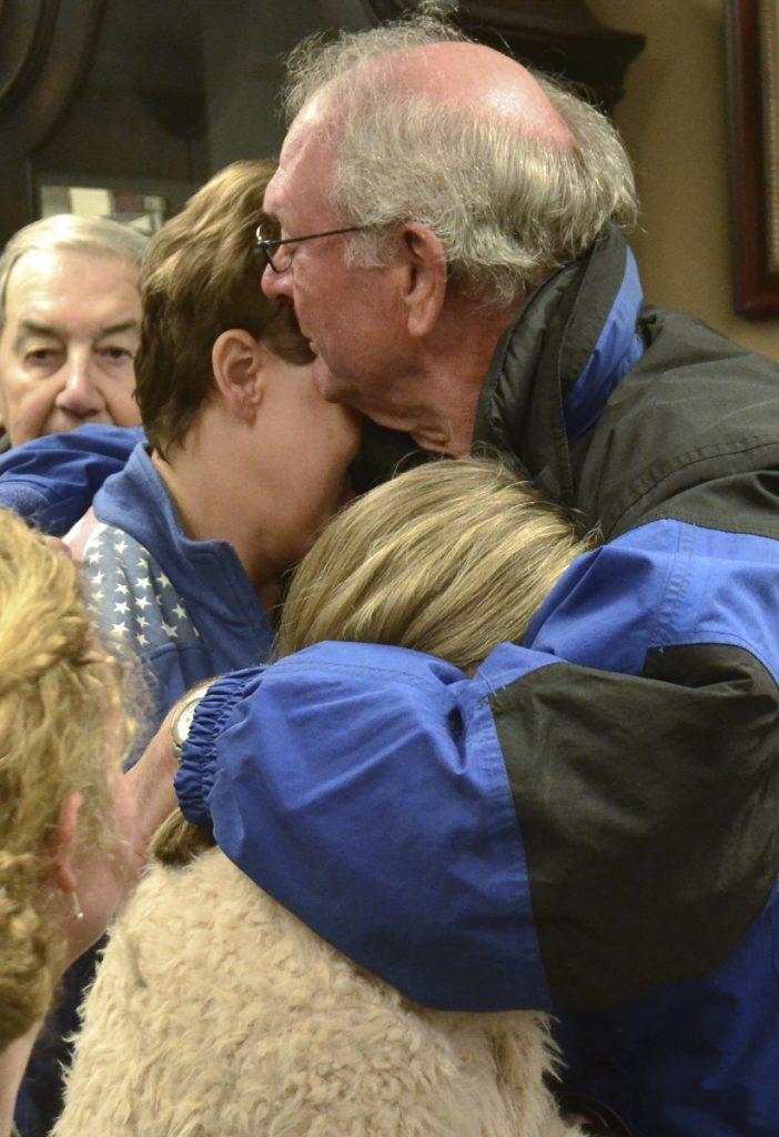 Mourners comfort one another prior to a prayer vigil at Briensburg Baptist Church near Benton, Ky., Tuesday, Jan. 23, 2018. Bailey Nicole Holt and Preston Ryan Cope, both 15, were killed and more than a dozen injured when a classmate opened fire Tuesday morning in the Marshall County High School atrium, a common area at the school where several hallways meet and students gather before classes. (AP Photo/Stephen Lance Dennee)