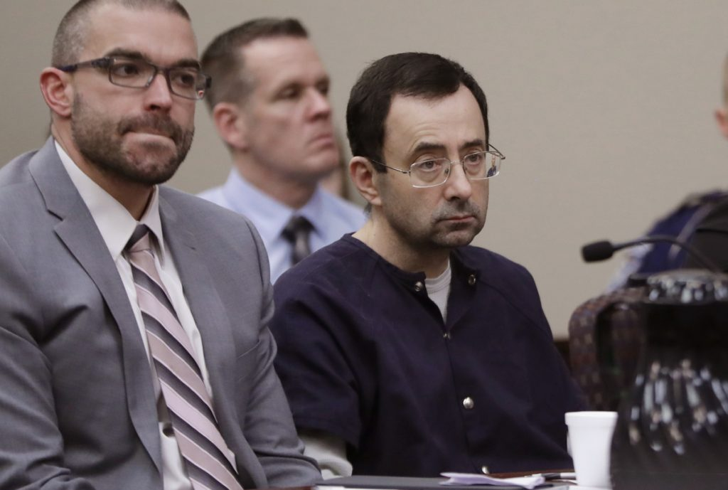 Larry Nassar sits with attorney Matt Newburg during his sentencing hearing Wednesday in Lansing, Mich. The former sports doctor who admitted molesting some of the nation's top gymnasts for years was sentenced to 40 to 175 years in prison.